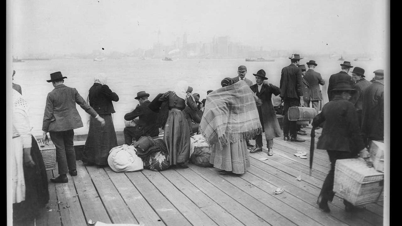 Immigrants waiting to be transferred, Ellis Island, Oct. 30, 1912. Credit...Library of Congress