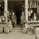 black and white image of a shop in the 1800's