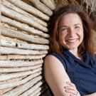 portrait of Katherine HayHoe leaning against a wall
