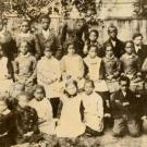 a sepia toned photo of african american children at school